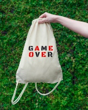 It Is Never Game Over Drawstring Bag lifestyle-drawstringbag-front-3