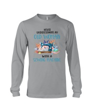 An Old Woman With A Sew Machine Long Sleeve Tee thumbnail