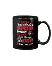 Never Underestimate A Firefighter Mug thumbnail