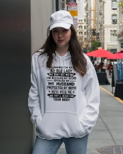 Protected by both Hooded Sweatshirt lifestyle-unisex-hoodie-front-5
