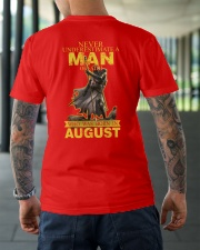 NEVER UNDERESTIMATE A MAN OF FAITH - AUGUST Classic T-Shirt lifestyle-mens-crewneck-back-3