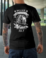 NEVER UNDERESTIMATE AN OLD MAN WAS BORN IN JULY Classic T-Shirt lifestyle-mens-crewneck-back-3