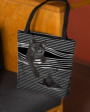 Black cat peeking All-over Tote aos-all-over-tote-lifestyle-front-02