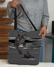 Black cat peeking All-over Tote aos-all-over-tote-lifestyle-front-10