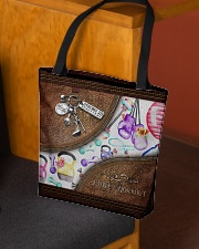 Strong Is Beautiful Leather Pattern Print All-over Tote aos-all-over-tote-lifestyle-front-02