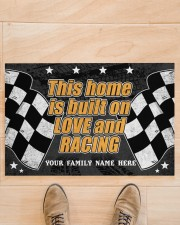 """This home is built on love and racing Doormat 22.5"""" x 15""""  aos-doormat-22-5x15-lifestyle-front-02"""
