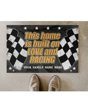 """This home is built on love and racing Doormat 22.5"""" x 15""""  aos-doormat-22-5x15-lifestyle-front-04"""