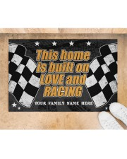 """This home is built on love and racing Doormat 22.5"""" x 15""""  aos-doormat-22-5x15-lifestyle-front-05"""