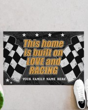 """This home is built on love and racing Doormat 22.5"""" x 15""""  aos-doormat-22-5x15-lifestyle-front-06"""
