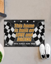 """This home is built on love and racing Doormat 22.5"""" x 15""""  aos-doormat-22-5x15-lifestyle-front-07"""