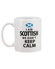 WE DON'T KEEP CALM Mug back