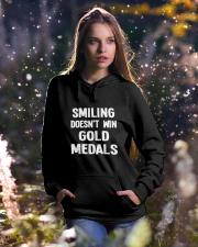 Smiling Doesn't Win Gold Medals Hooded Sweatshirt lifestyle-holiday-hoodie-front-5