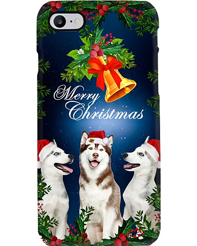 Siberian Husky under Christmas bell