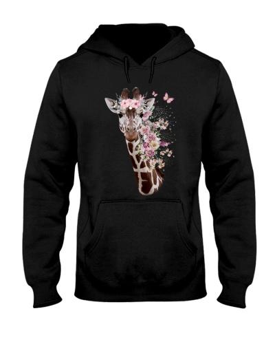 Giraffe with flower hair