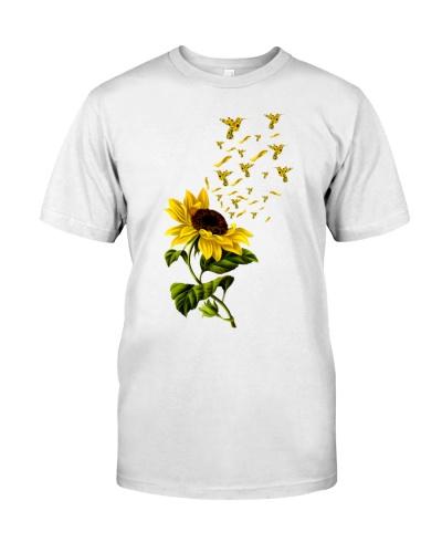 Hummingbird sunflowers fly