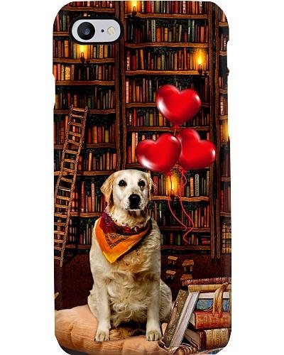 Golden retriever full of books