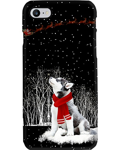 Siberian husky is watching the snow