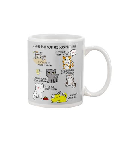 Cat signs mug