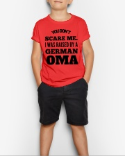 I WAS RAISED BY A GERMAN OMA Youth T-Shirt lifestyle-youth-tshirt-front-1